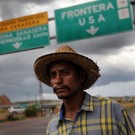 Mexican immigrant walks along the U.S.- Mexico border after being deported from Arizona to Nogales, Mexico.