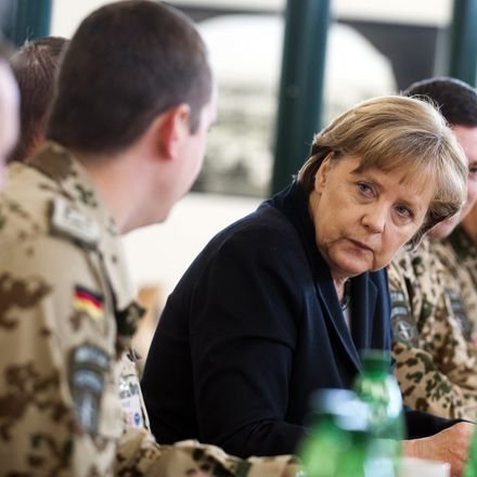 German Chancellor Angela Merkel talks with German soldiers at a dining facility based in Afghanistan.