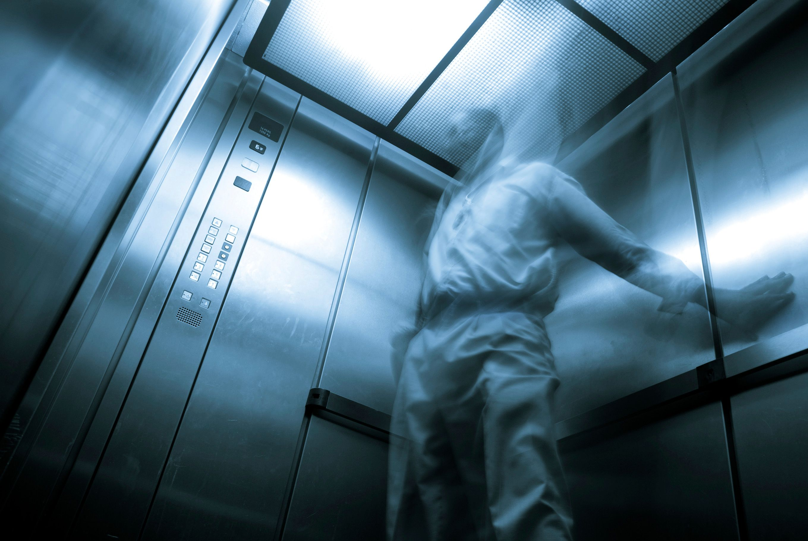 A man trapped in an elevator.