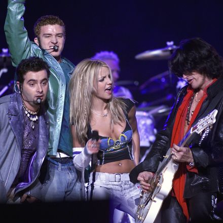 All performers on stage, Britney in center, N'Sync surrounding her as they are all performing.