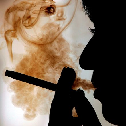 The silhouette of a Greek woman smoking is seen in Athens one day ahead of WHO World No Tobacco Day. According to European Union research, Greek people are the top smokers in the list of European countries with 42 per cent.