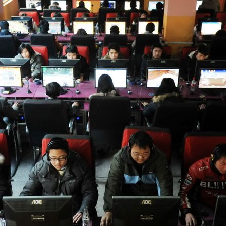 People crowd into an internet cafe in China.
