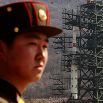 16 Feb 2013, North Korea --- A soldier stands guard in front of the Unha-3 (Milky Way 3) rocket sitting on a launch pad at the West Sea Satellite Launch Site, during a guided media tour by North Korean authorities in the northwest of Pyongyang in this Apr