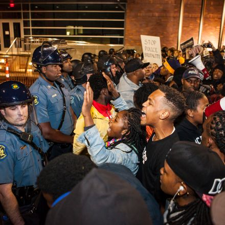 Demonstrators confront police during a protest outside the Ferguson Police Station on Friday, October 10, 2014.