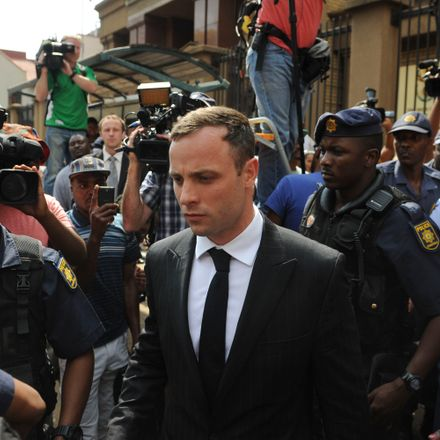 Oscar Pistorius leaves the Pretoria High Court in Pretoria, South Africa.