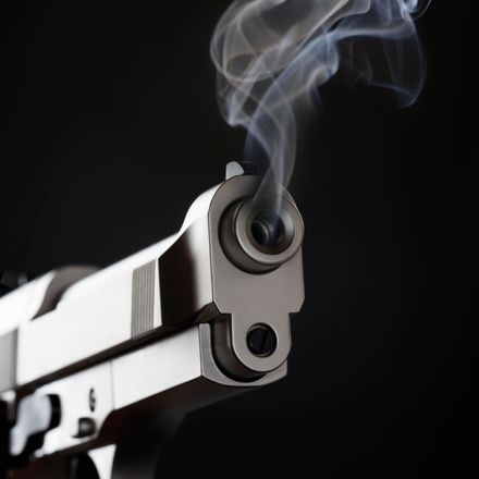 Gun with smoke coming out of it.