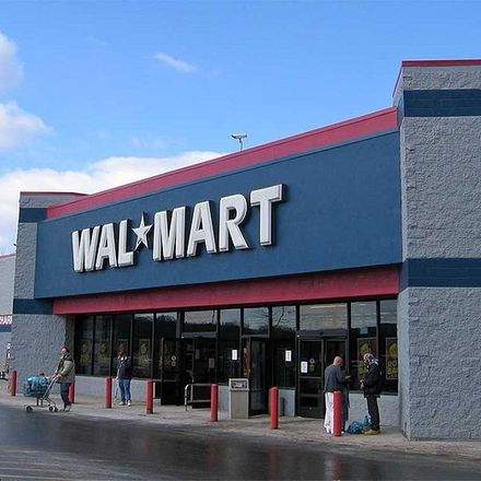 Exterior of WalMart, with blue paint and white letters