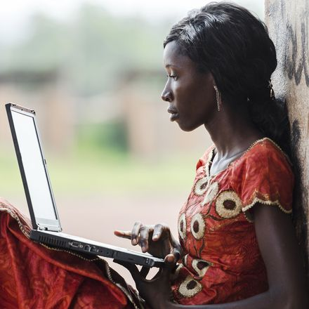 african woman with laptop shutterstock 246583168