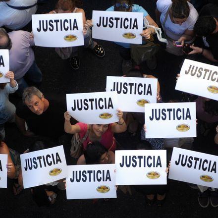 Citizens hold placards that read 'Justice' during a rally in front of the headquarters of the AMIA (Argentine Israelite Mutual Association), in Buenos Aires on January 21, 2015, to protest against the death of Argentine public prosecutor Alberto Nisman, w