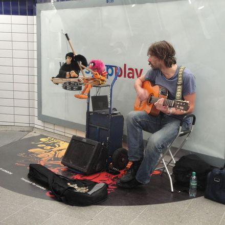 busker at piccadilly circus tube station in march 2012