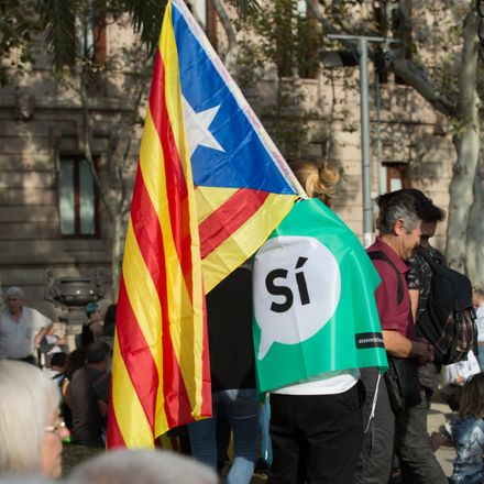 catalonia independence supporter with si sign shutterstock 737084686