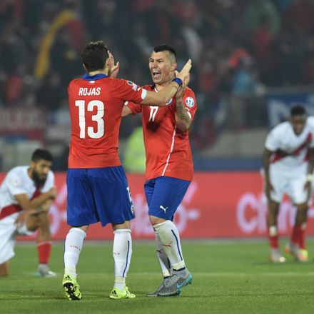 Chile's Jose Manuel Rojas and Gary Medel celebrate after defeating Peru 2-1 during their 2015 Copa America football championship semi-final match, in Santiago, on June 29, 2015.