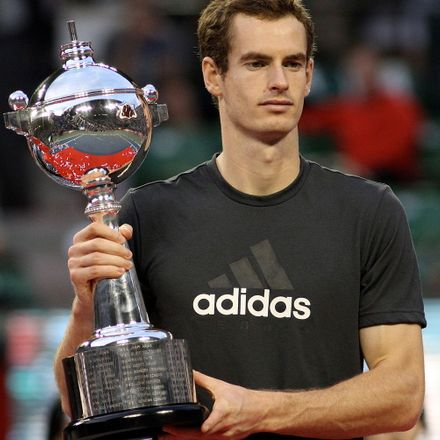 Andy Murray carrying a trophy