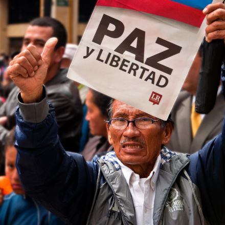 colombian with paz y liberdad sign anti farc protest shutterstock 181810163