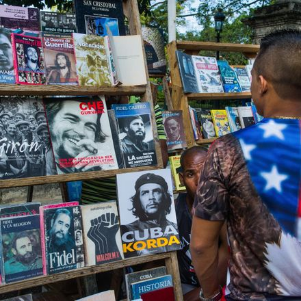 A Cuban wearing a t-shirt with the US flag walks along a street of Havana, on January 16, 2015. The United States will ease travel and trade restrictions with Cuba on Friday, marking the first concrete steps towards restoring normal ties with the Cold War
