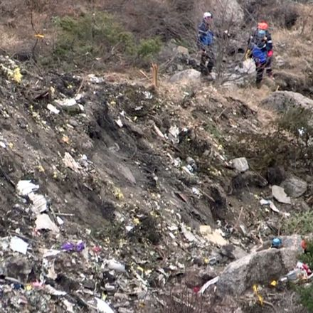 A screengrab taken from an AFP TV video on March 24, 2015 shows search and rescue personnel at the crash site of the Germanwings Airbus A320 in the French Alps above the southeastern town of Seyne.