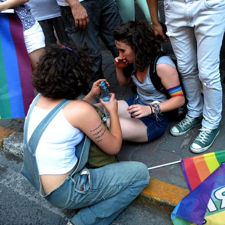 An injured protestor during the Pride parade
