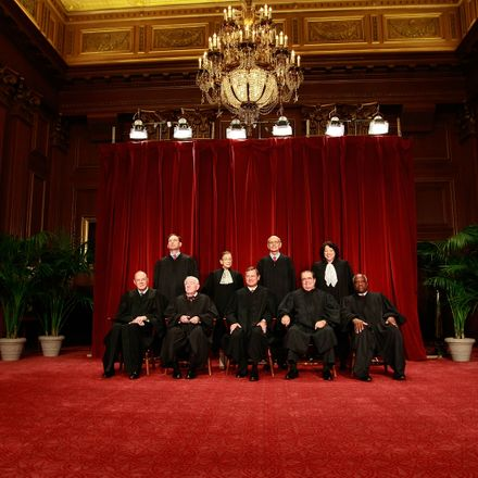 Members of the US Supreme Court pose for a group photograph at the Supreme Court building on September 29, 2009