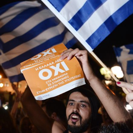 People celebrate in Athens on July 5, 2015 after the first exit-polls of the Greek referendum. Over 60 percent of Greeks rejected further austerity dictated by the country's EU-IMF creditors in a referendum, results from 20 percent of polling stations sho