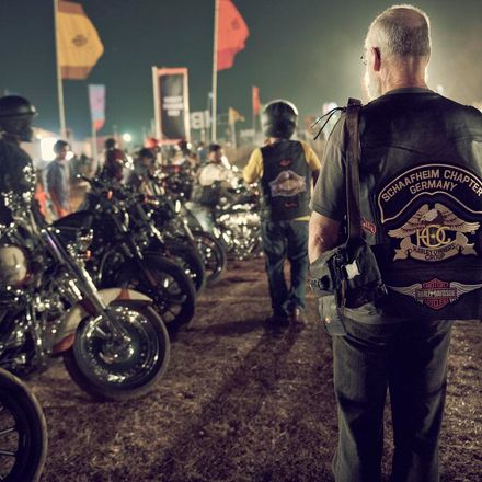 A HOG member from Schaafheim Germany inspects a line up of Harley-Davidson motorcycles at IBW.