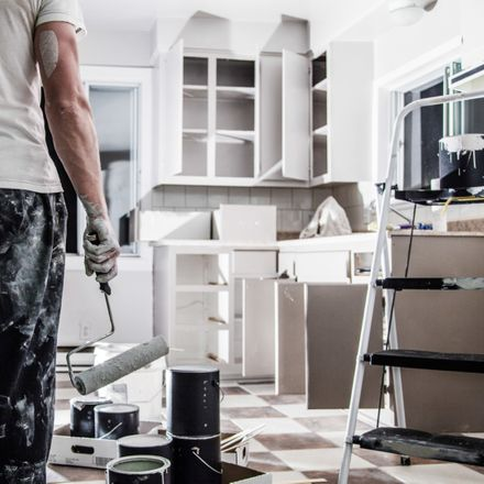 kitchen renovation man with paint roller shutterstock 220534573
