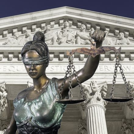 lady justice and supreme court shutterstock 560959042