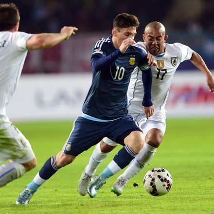 Argentina's forward Lionel Messi (C) is marked by Uruguay's midfielder Egidio Arevalo Rios (R) and Cristian Rodriguez during their 2015 Copa America football championship match, in La Serena, Chile, on June 16, 2015