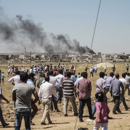 A crowd gathers to watch ISIS assault on Kobane, Syria, from the other side of the Turkish border.