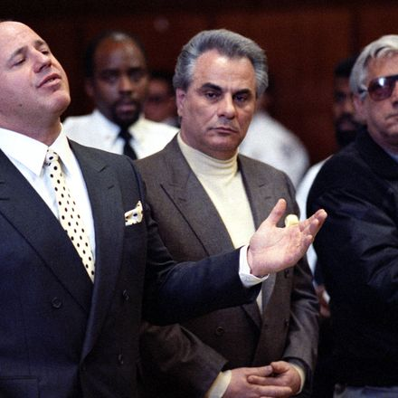 John Gotti, center, at his arraignment. At left is Gotti's lawyer, Bruce Cutler and right is another defendent Anthony Guerrieri.