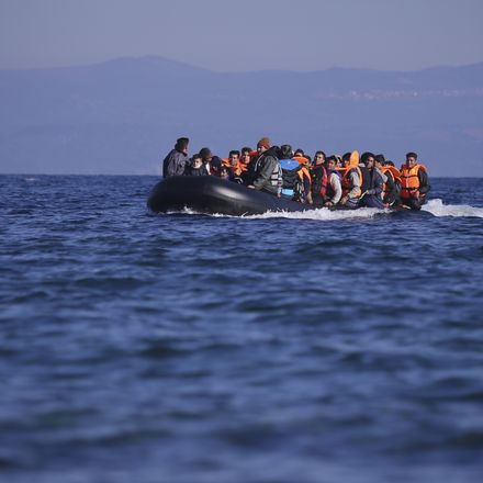 migrants in boat shutterstock 356234243