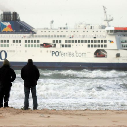 Illegal immigrants watch as a ferry leaves bound for England, February 14, 2005 in Calais, France