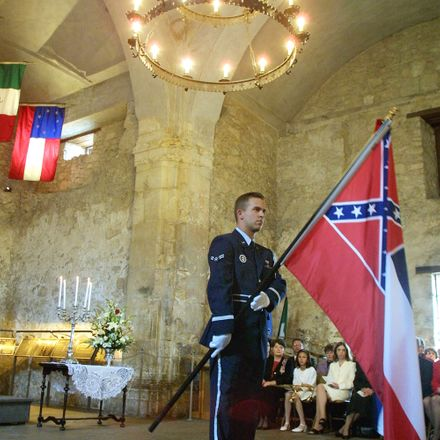 A color guard member presents the Mississippi state flag during the Annual Memorial Service at the Alamo, March 6, 2001 in San Antonio, Texas. On April 17, 2001