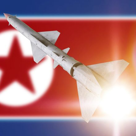 north korea missile on flag shutterstock 687626749