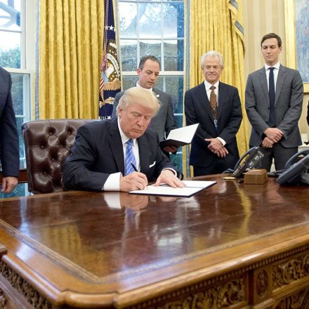president trump signs executive orders as mike pence and staff look on 23 jan 2017 white house