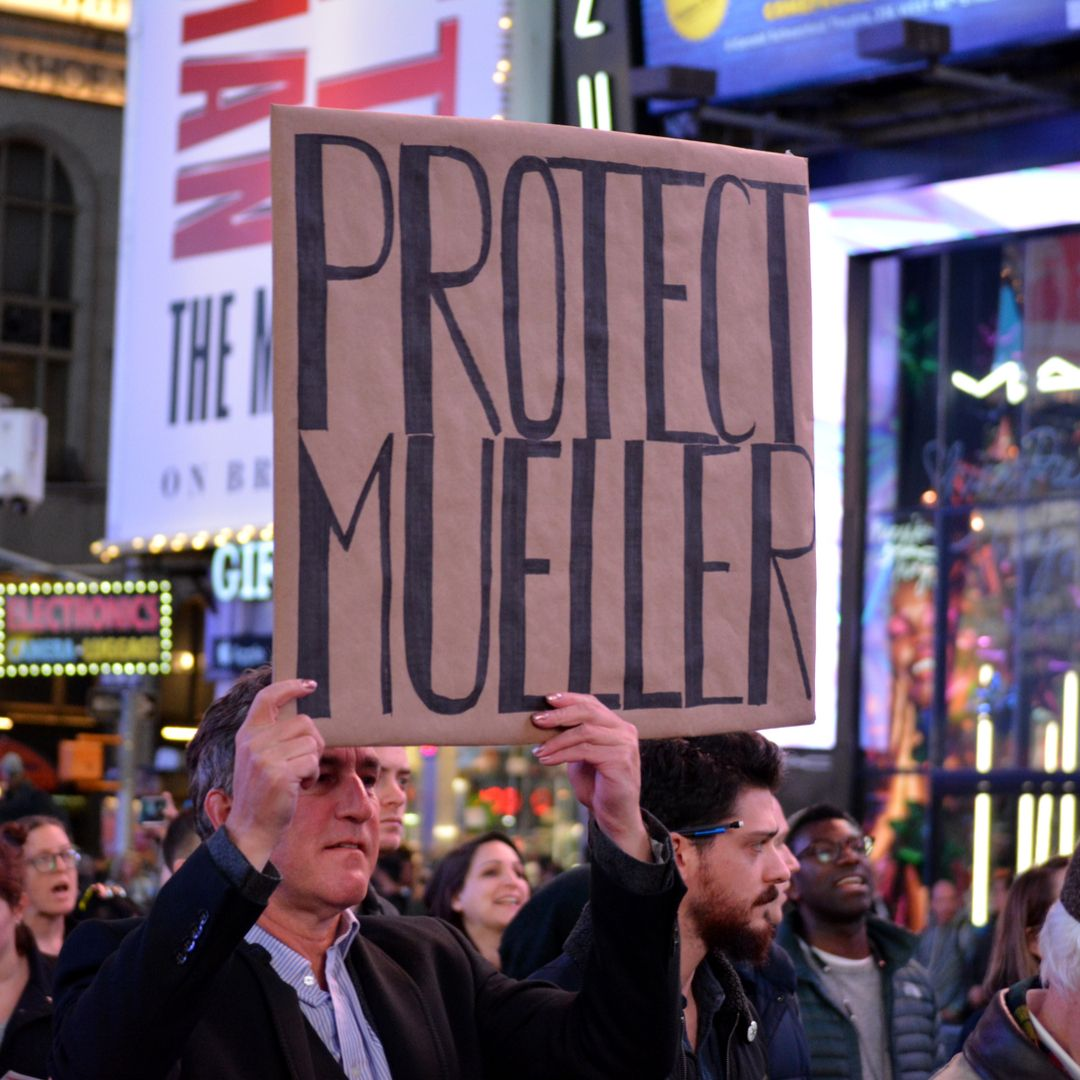 protect mueller sign at protest shutterstock 1225340527
