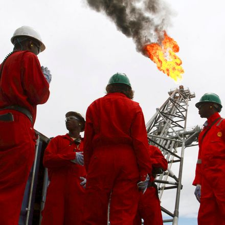 Workers discuss on the deck of an oil tanker at Bonga off-shore oil field outside Lagos, October 30, 2007.