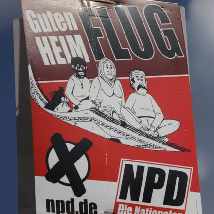 racist german far right party campaign poster shutterstock 191172905