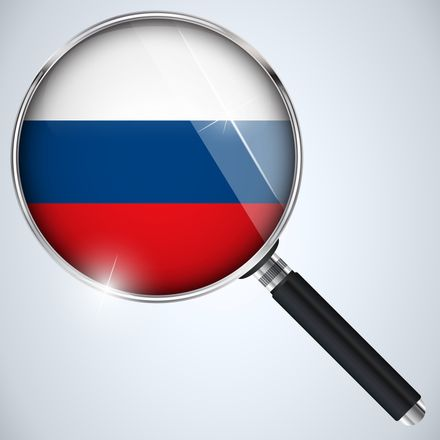 russia investigation magnifying glass flag shutterstock 164664809
