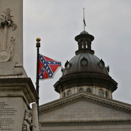 The Confederate battle flag flies on the grounds of the South Carolina Statehouse, where the state's governor and key politicians are now urging its removal in the wake of racist killings in Charleston.