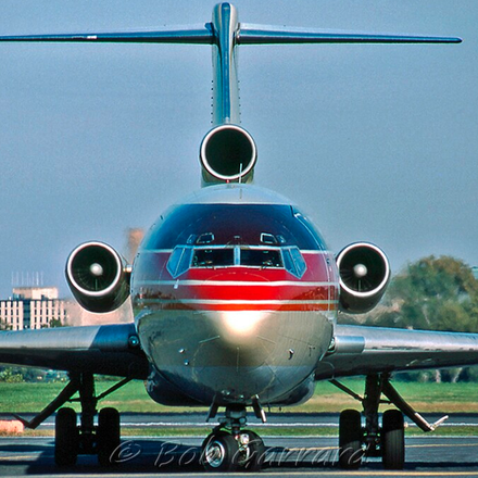Airplane facing directly forward towards camera outdoors on the tarmac