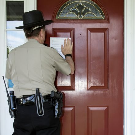 sheriff posting eviction notice shutterstock 453267406