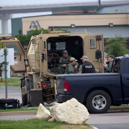Law enforcement officers from around the area including the FBI and ATF are investigating the scene and providing security near Twin Peaks restaurant on Monday, May 18, 2015, where a shooting between rival biker gang members left nine dead Sunday in Waco,
