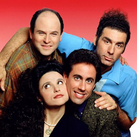 Group photo of Seinfeld characters on red backdrop