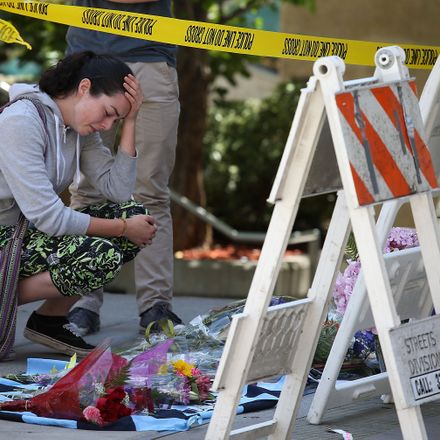 A woman cries as she leaves flowers at the scene of a balcony collapse in Berkeley, Calif., where six young people were killed.