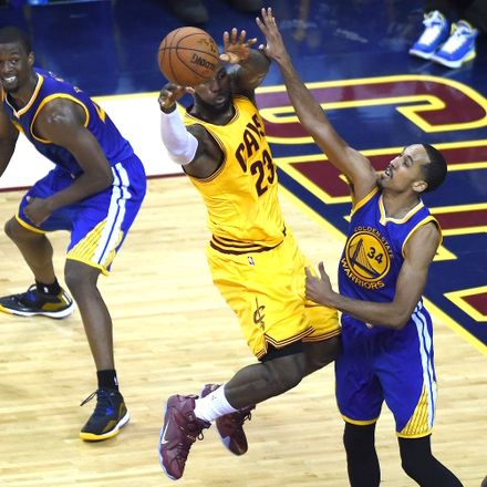Cleveland's LeBron James vies with Golden State Warriors Shaun Livingston in Game 4.