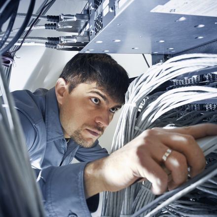 checking wires at data center shutterstock 314071445