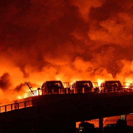 Fire and smoke are seen after explosions at a warehouse last night in Tianjin, China. Source: Getty