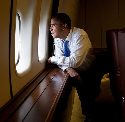 President Obama stares out of his airplane window.