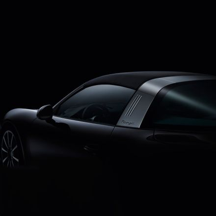 Porsche roof of 911 targa photographed on black background and moody studio