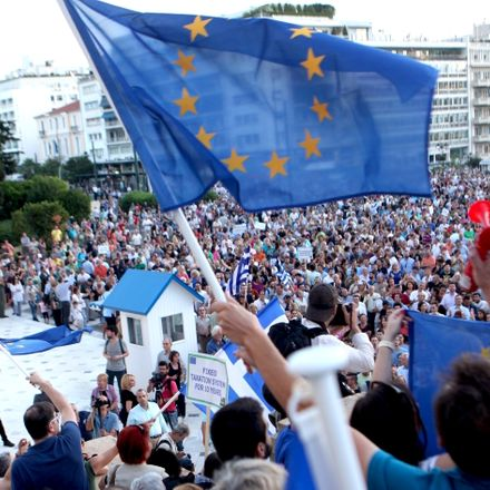 Anti-government demonstrators rally in Athens demand that Greece remain in the eurozone.